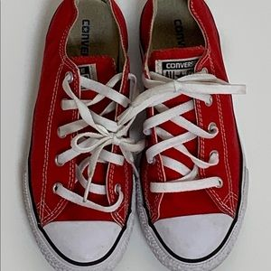 Red canvas Converse sneaker.